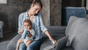 woman working remotely with child